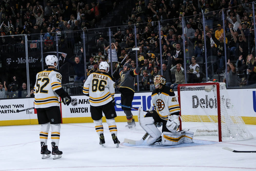 Vegas Golden Knights right wing Alex Tuch (89), center, celebrates after scoring against the Boston Bruins during the second period of an NHL hockey game at T-Mobile Arena in Las Vegas, Sunday, Oc ...
