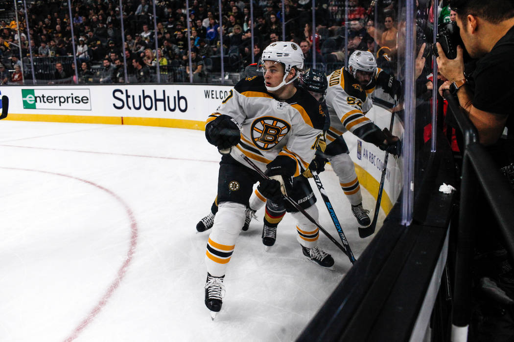 Boston Bruins left wing Anders Bjork (10), left, skates on the rink after chasing the puck against the Vegas Golden Knights during the second period of an NHL hockey game at T-Mobile Arena in Las  ...