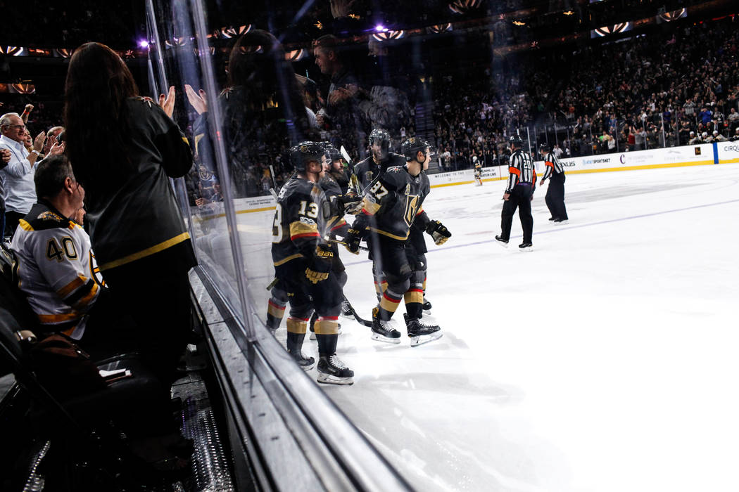 Vegas Golden Knights center Vadim Shipachyov (87), right, celebrates after scoring against the Boston Bruins during the second period of an NHL hockey game at T-Mobile Arena in Las Vegas, Sunday,  ...