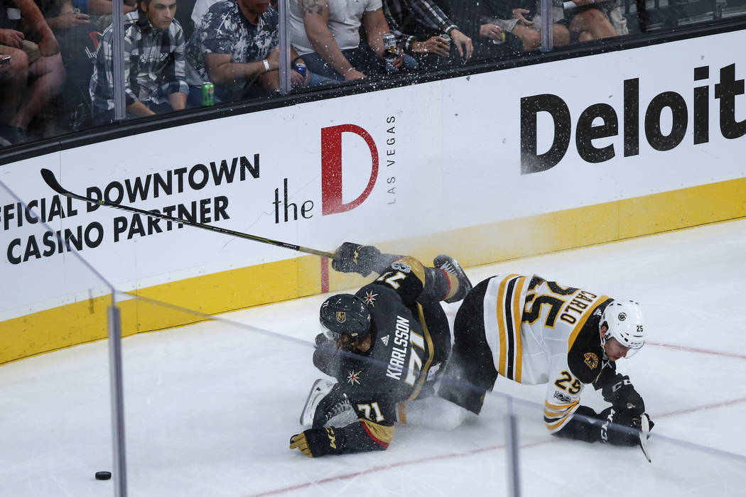 Vegas Golden Knights center William Karlsson (71), left, and Boston Bruins defenseman Brandon Carlo (25), right, collide during the third period of an NHL hockey game at T-Mobile Arena in Las Vega ...