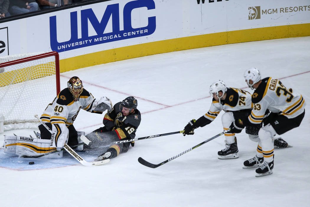 Vegas Golden Knights right wing Reilly Smith (19), second from left, sides before colliding into Boston Bruins goalie Tuukka Rask (40), left, during the third period of an NHL hockey game at T-Mob ...