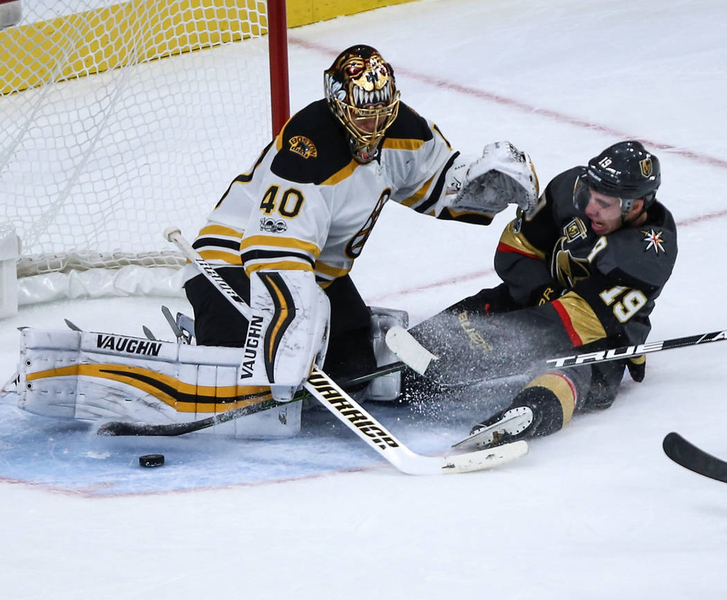 Vegas Golden Knights right wing Reilly Smith (19) sides before colliding into Boston Bruins goalie Tuukka Rask (40), left, during the third period of an NHL hockey game at T-Mobile Arena in Las Ve ...