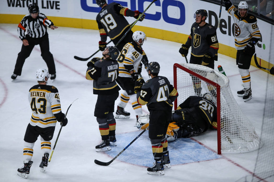 Vegas Golden Knights center William Karlsson (71), center, stands in disappointment after being scored on by the Boston Bruins during the third period of an NHL hockey game at T-Mobile Arena in La ...