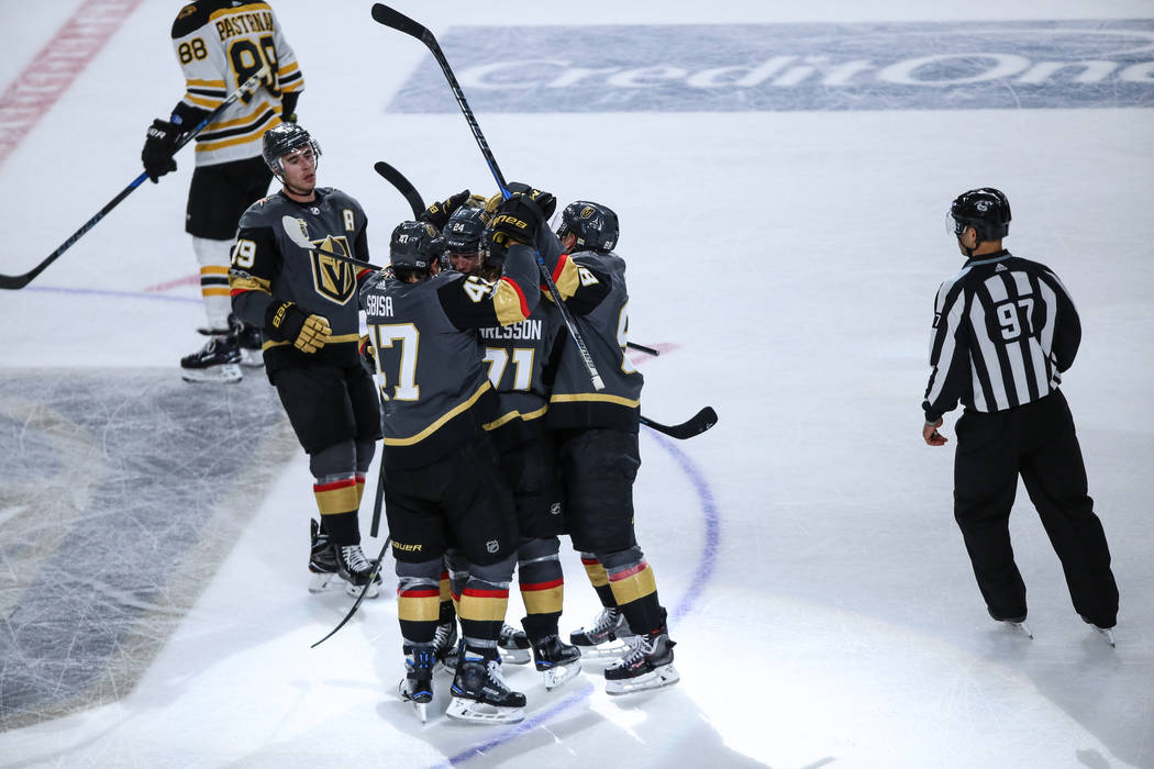 Vegas Golden Knights celebrate after Vegas Golden Knights center Oscar Lindberg (24), center, scored during the third period of an NHL hockey game at T-Mobile Arena in Las Vegas, Sunday, Oct. 15,  ...
