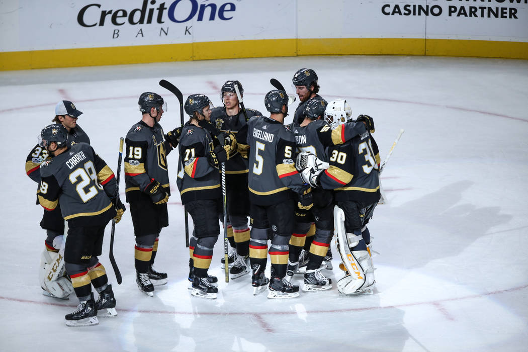 Vegas Golden Knights celebrate after defeating the Boston Bruins during the third period of an NHL hockey game at T-Mobile Arena in Las Vegas, Sunday, Oct. 15, 2017. Vegas Golden Knights won 3-1.  ...
