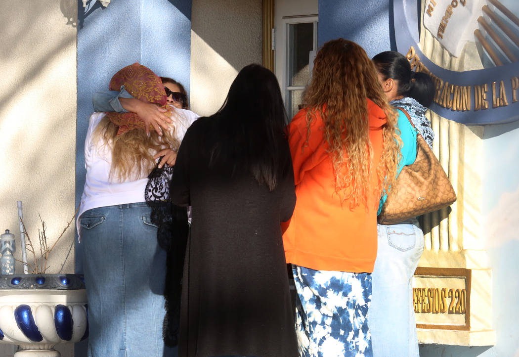 Church goers gather outside Iglesia La Luz Del Mundo at Cedar Street where a man suffering gunshot wounds to his head and shoulder was found near Eastern Avenue Monday, Oct. 16, 2017, in Las Vegas ...