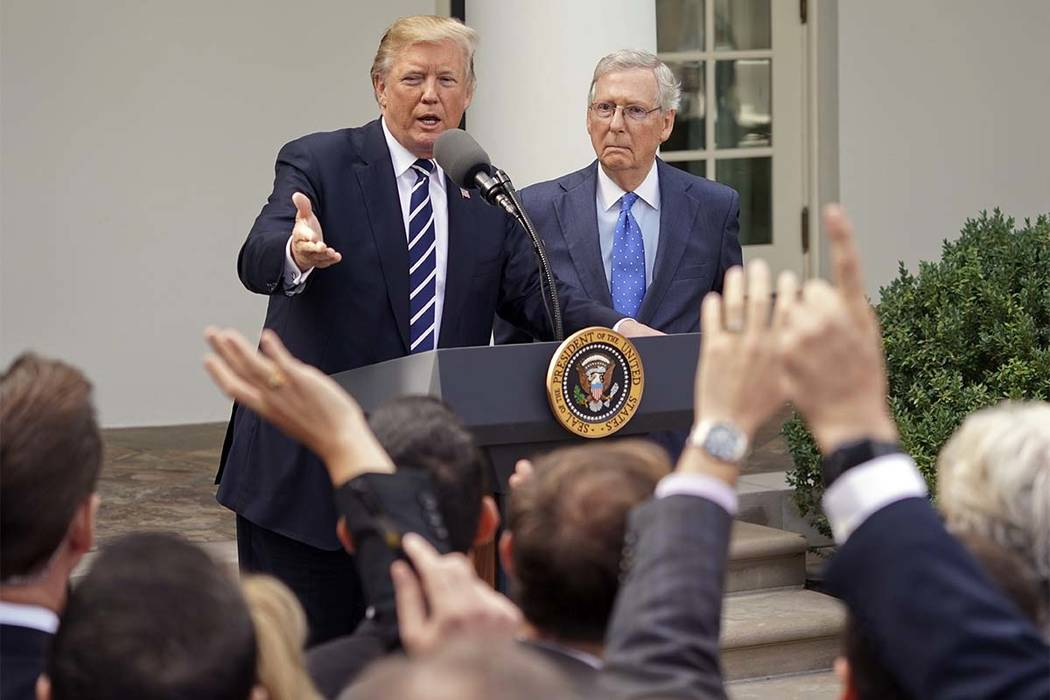 President Donald Trump and Senate Majority Leader Mitch McConnell of Ky., speak to members of the media in the Rose Garden of the White House, Monday, Oct. 16, 2017. (AP Photo/Pablo Martinez Monsi ...