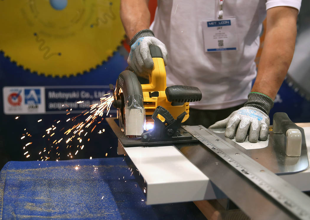 John Yu, sales manager fro Global Saw, demonstrates how he uses a circular saw blade to cut sheet metal during the 2017 MetalCon Expo at the Las Vegas Convention Center Wednesday, Oct. 18, 2017. B ...