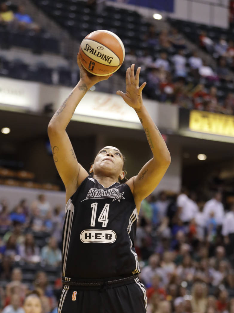 San Antonio Stars' Erika de Souza (14) shoots during the first half of a WNBA basketball game against the Indiana Fever, Wednesday, July 12, 2017, in Indianapolis. (AP Photo/Darron Cummings)