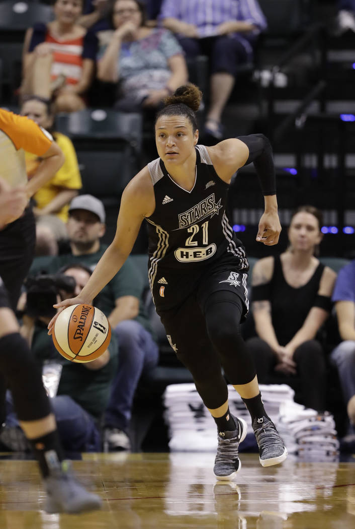 San Antonio Stars' Kayla McBride (21) in action during the first half of a WNBA basketball game against the Indiana Fever, Wednesday, July 12, 2017, in Indianapolis. (AP Photo/Darron Cummings)