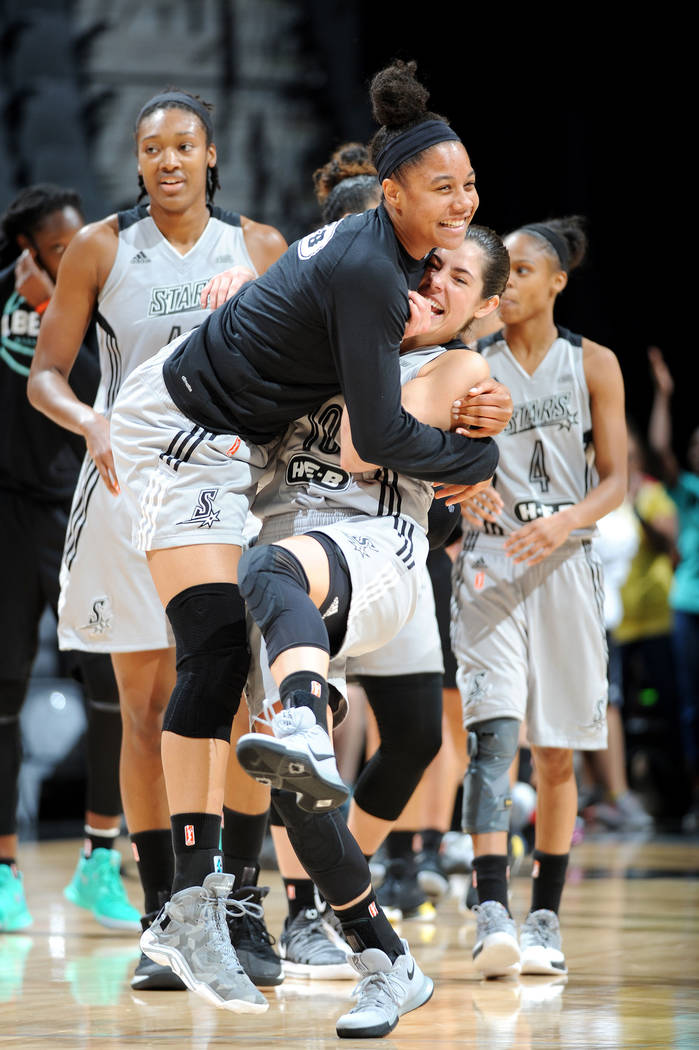 SAN ANTONIO, TX - AUGUST 1: Kelsey Plum #10 of the San Antonio Stars and Nia Coffey #12 of the San Antonio Stars react after the game against the New York Liberty during a WNBA game on August 1, 2 ...