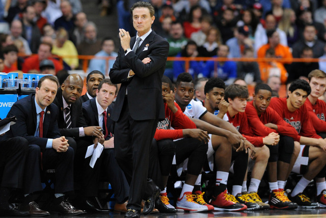 Mar 27, 2015; Syracuse, NY, USA; Louisville Cardinals head coach Rick Pitino during the first half against the North Carolina State Wolfpack in the semifinals of the east regional of the 2015 NCAA ...