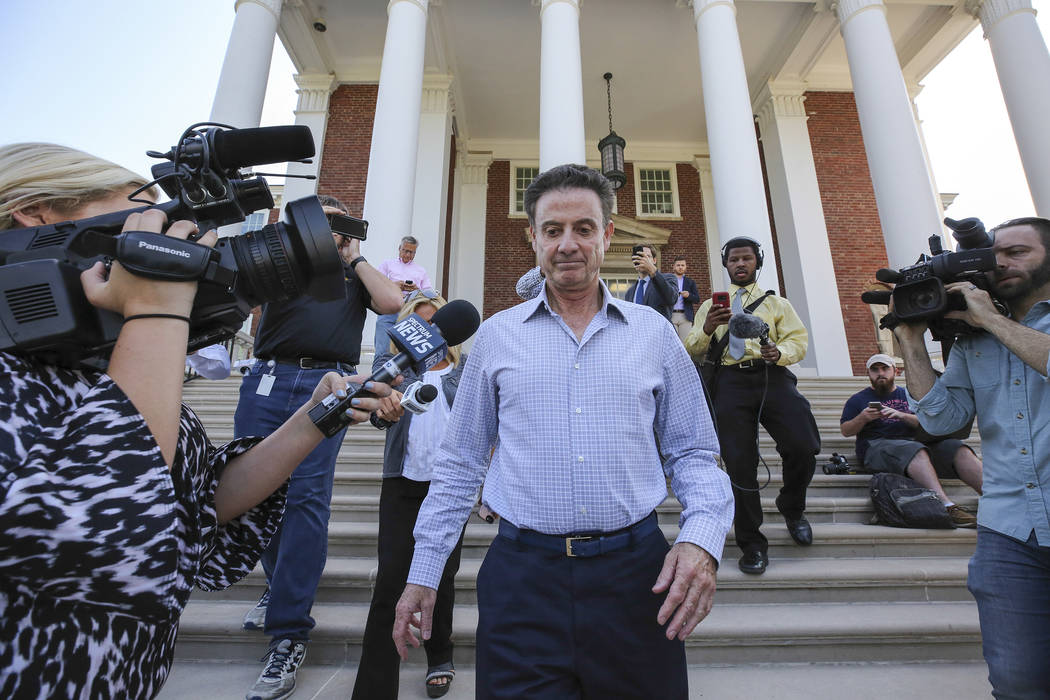 In this Wednesday, Sept. 27, 2017, file photo, Louisville men's basketball coach Rick Pitino leaves Grawemeyer Hall after having a meeting with the university's interim president Greg Postel in Lo ...