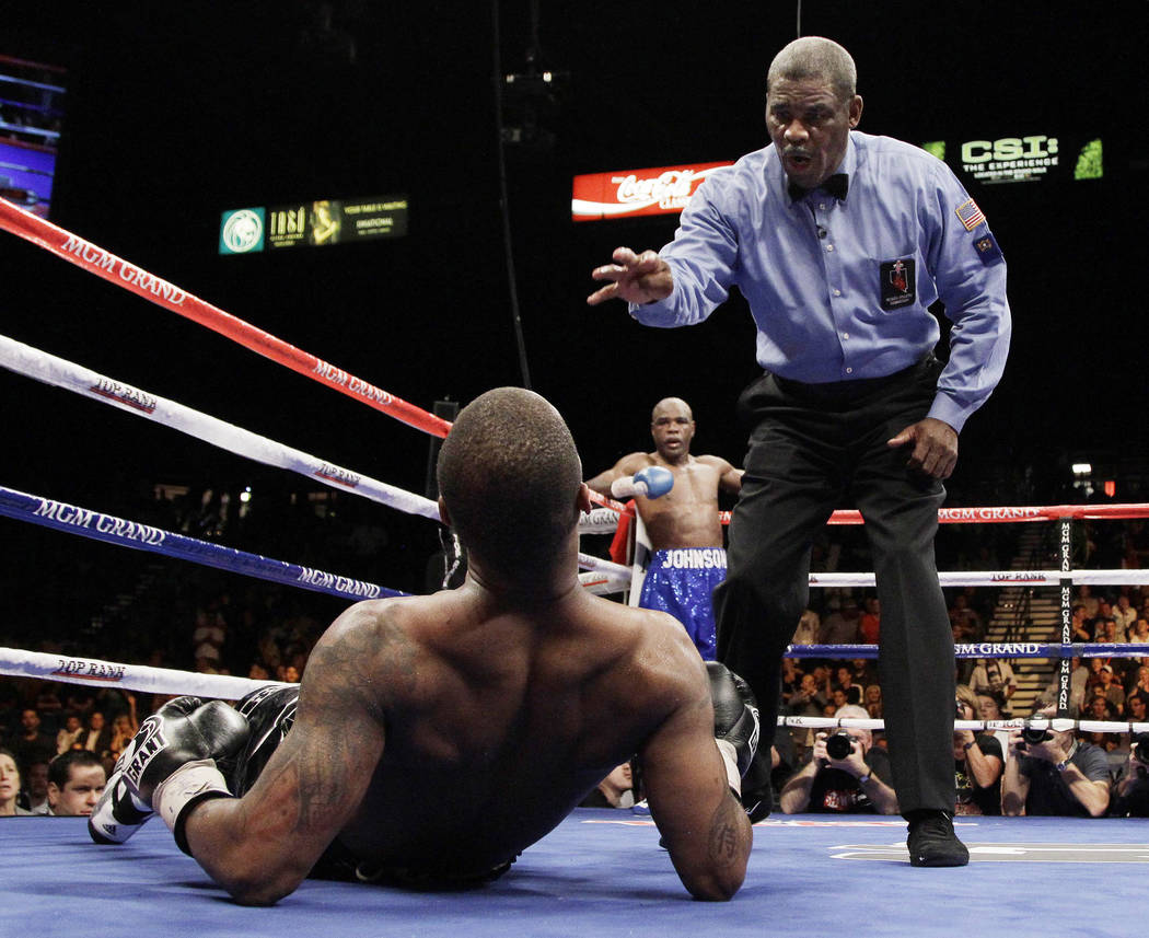 Referee Robert Byrd issues the count after Allan Green was knocked down by Glen Johnson in the eighth round during a super middleweight bout Saturday, Nov. 6, 2010, in Las Vegas. Johnson won by kn ...