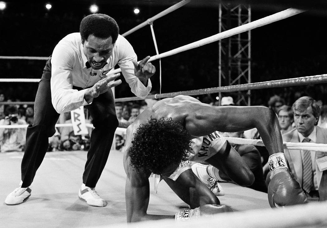 "Referee Richard Steele continues his count as Thomas ""Hitman"" Hearns struggles to his feet after being knocked out in the third round of Monday night's fight, April 16, 1985 in L ..."