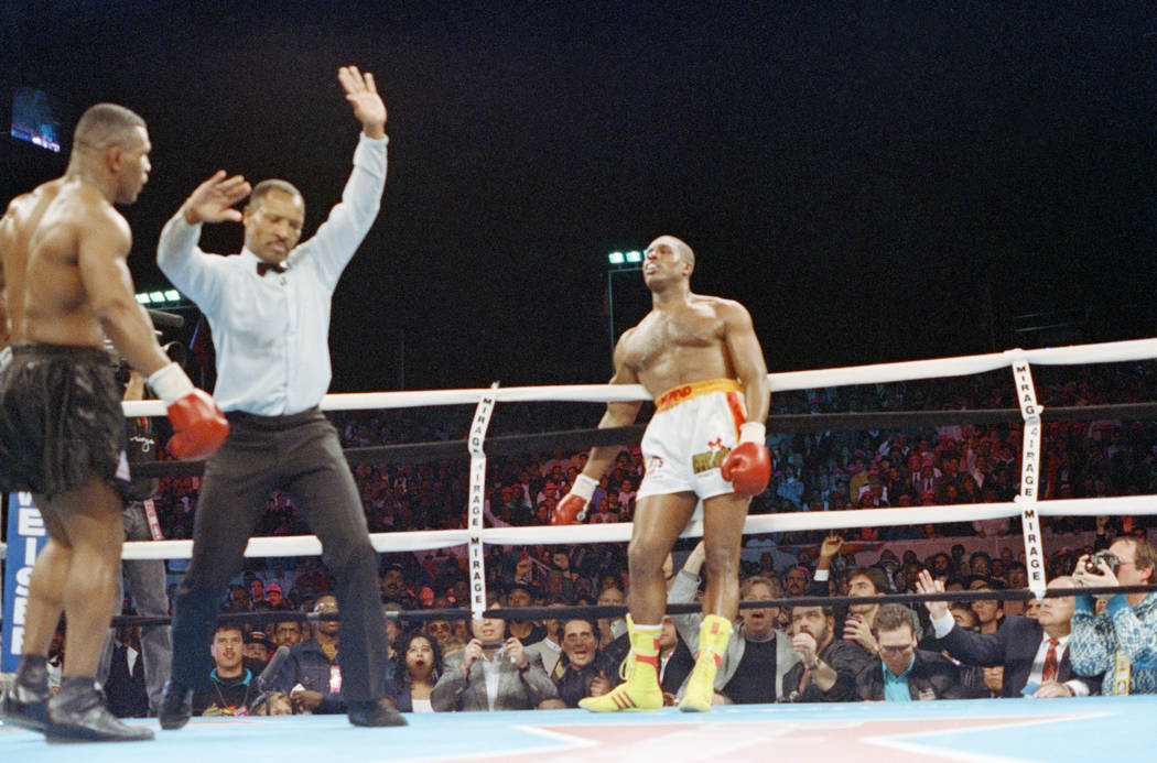Referee Richard Steele stops the fight in the seventh round after Donvovan ?Razor? Ruddock was hit by Mike Tyson resulting in a TKO ending their heavyweight bout at the Mirage in Las Vegas, Monday ...