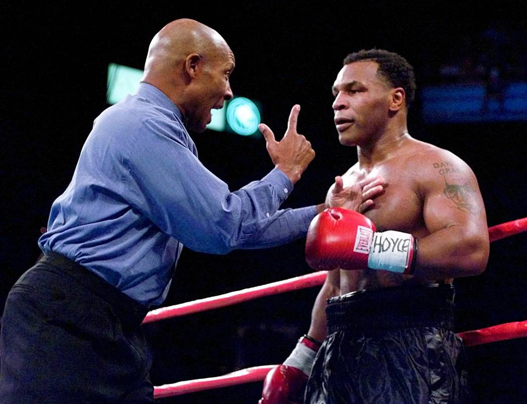 Referee Richard Steele speaks to Mike Tyson after separating him from Orlin Norris just prior to the end of the first round during their heavyweight bout at the MGM Grand Garden in Las Vegas, Satu ...