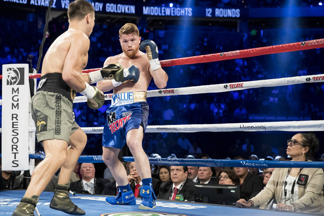 Judge Adalaide Byrd, right, watches Gennady GGG Golovkin, left, and Saul Canelo Alvarez fight in the WBC, WBA, IBF, RING middleweight title bout at T-Mobile Arena in Las Vegas, Saturday, Sept. 16, ...