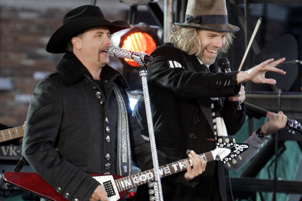 John Rich, left, and Kenny Alphin of the country music duo Big & Rich perform in Nashville, Tenn., Wednesday, Nov. 7, 2007 outside the Sommet Center, where the Country Music Association Awards ...