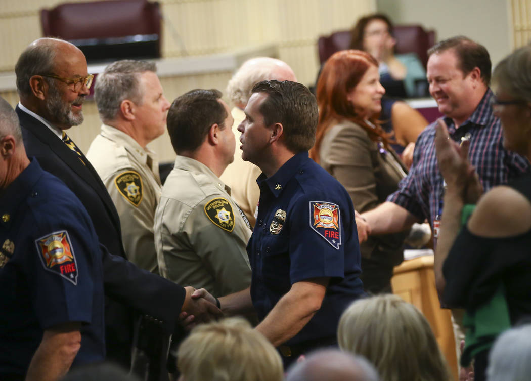 Ryan Turner, division chief of emergency management and safety at the Henderson Fire Department, center right, as first responders in the Oct. 1 shooting are recognized during a Henderson City Cou ...