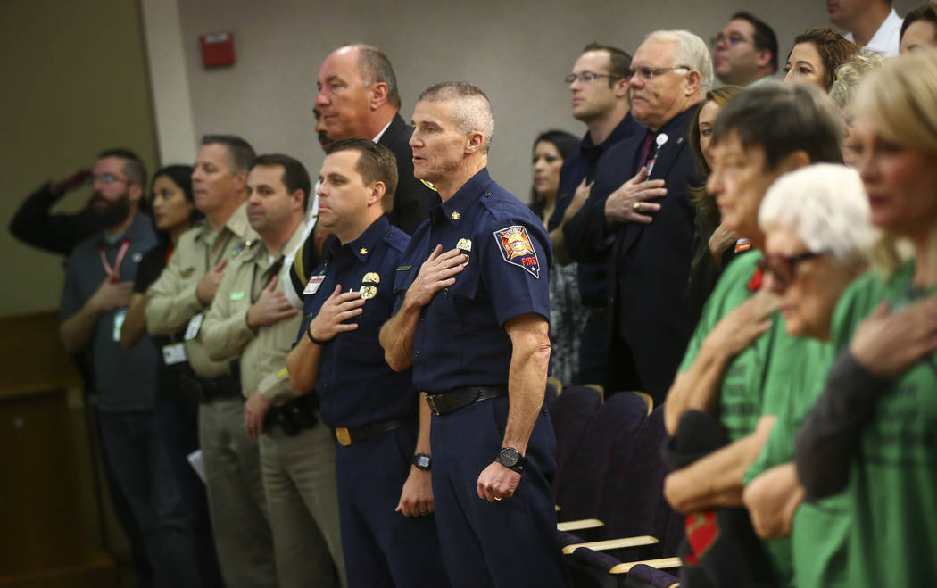 Henderson Fire Department Chief Shawn White, center, during the national anthem with first responders in the Oct. 1 shooting before being honored during a Henderson City Council meeting on Tuesday ...