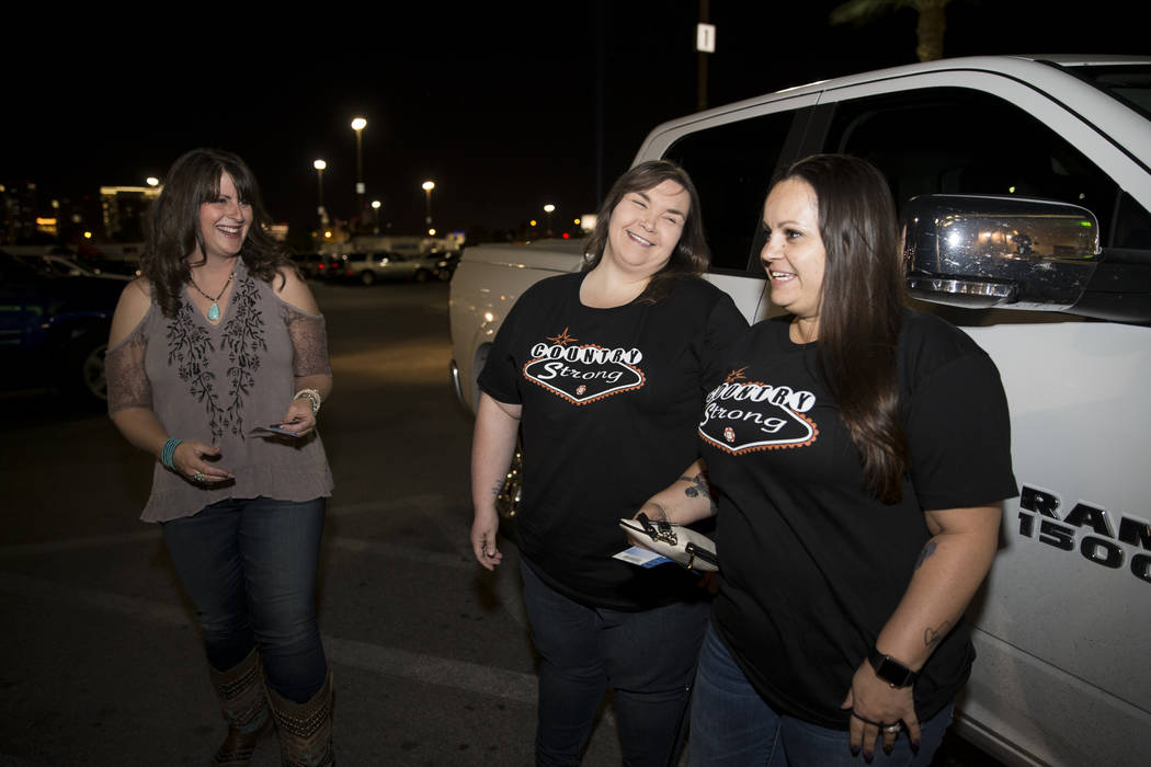 Anna Kopp, from left, with her friends Michele Langlois, and Amber Diskin, before the Vegas Strong benefit concert, at the Orleans Arena in Las Vegas, Thursday, Oct. 19, 2017. Erik Verduzco Las Ve ...
