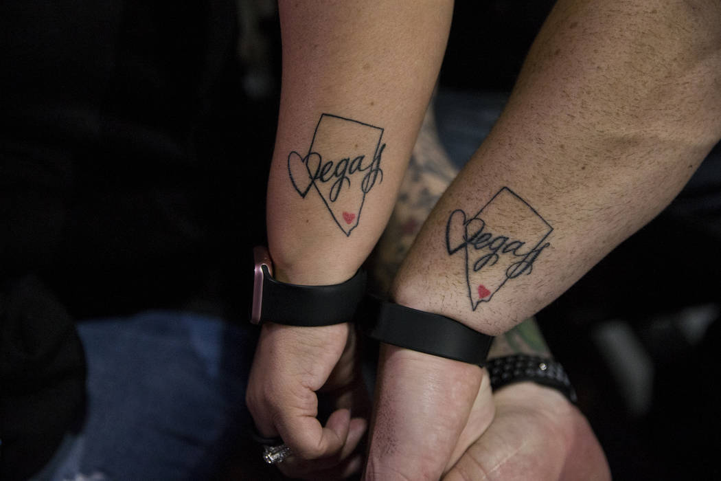 Amber Diskin, left, and her husband Mark, show their matching tattoos before a Vegas Strong benefit concert, at the Orleans Arena in Las Vegas, Thursday, Oct. 19, 2017. Erik Verduzco Las Vegas Rev ...