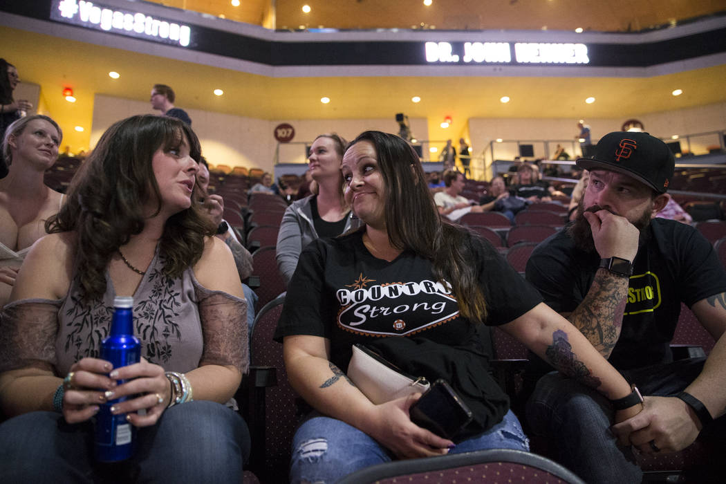 Anna Kopp, from left, and her friend Amber Diskin with her husband Mark, during a Vegas Strong benefit concert, at the Orleans Arena in Las Vegas, Thursday, Oct. 19, 2017. Erik Verduzco Las Vegas  ...