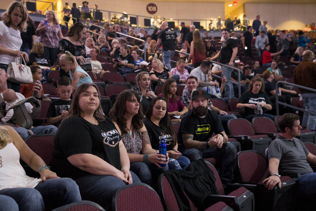 Michele Langlois, from left, with her friends Anna Kopp, and Amber Diskin with her husband Mark, during a Vegas Strong benefit concert, at the Orleans Arena in Las Vegas, Thursday, Oct. 19, 2017.  ...