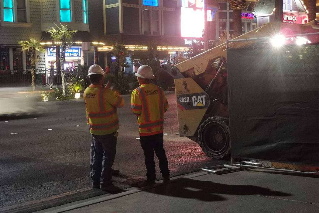 Construction workers check for utility lines near the Mirage as plans to install about 700 bollards on the Strip began on Oct. 17, 2017. (Max Michor/Las Vegas Review-Journal)