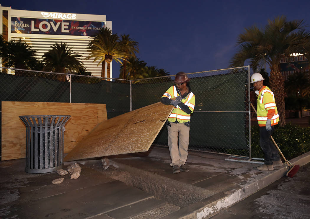 Project workers at the Strip bollards project site Tuesday, Oct. 17, 2017, in front of the Mirage hotel-casino. The steel bollards project will be completed without impacting pedestrian or vehicle ...