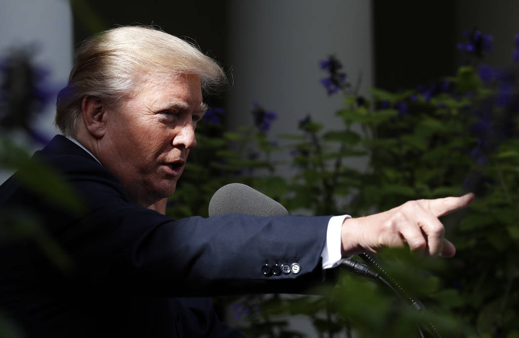 President Donald Trump points to a reporter to ask a question during a media availability in the Rose Garden with Senate Majority Leader Mitch McConnell of Ky., after their meeting at the White Ho ...
