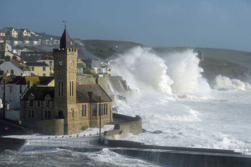 Waves break around the church in the harbor at Porthleven, Cornwall southwestern England, as the remnants of Hurricane Ophelia begins to hit parts of Britain and Ireland. Ireland's meteorological  ...