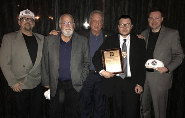 Jesus Campos, the Mandalay Bay security guard who first encountered mass shooter Stephen Paddock, second from right, is shown in an image provided by the International Union, Security, Police and  ...