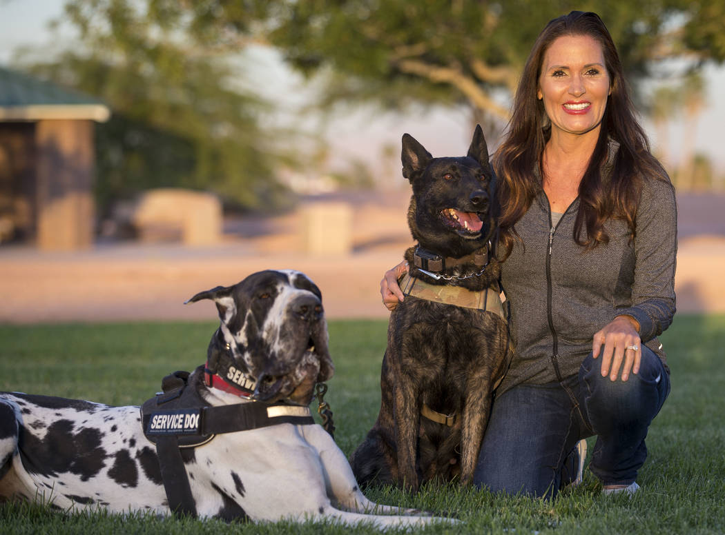Club K9 owner and service dog trainer Susan Davis with her Great Dane Goomba and Dutch Shepherd Luna during a visit to the Firefighters Memorial Park in Las Vegas on Tuesday, Oct. 17, 2017. Richar ...