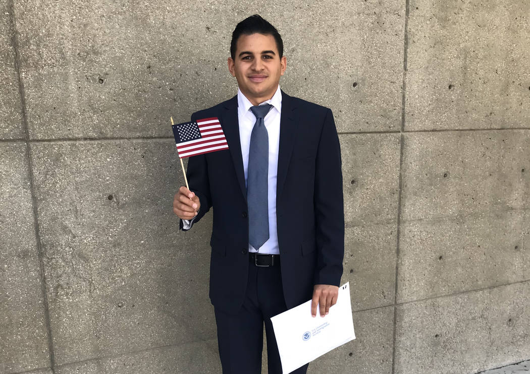 Chapman Automotive  Robert Hernandez, a sales associate at Chapman Dodge Chrysler Jeep Ram, waves his American flag at the federal courthouse after earning his citizenship.