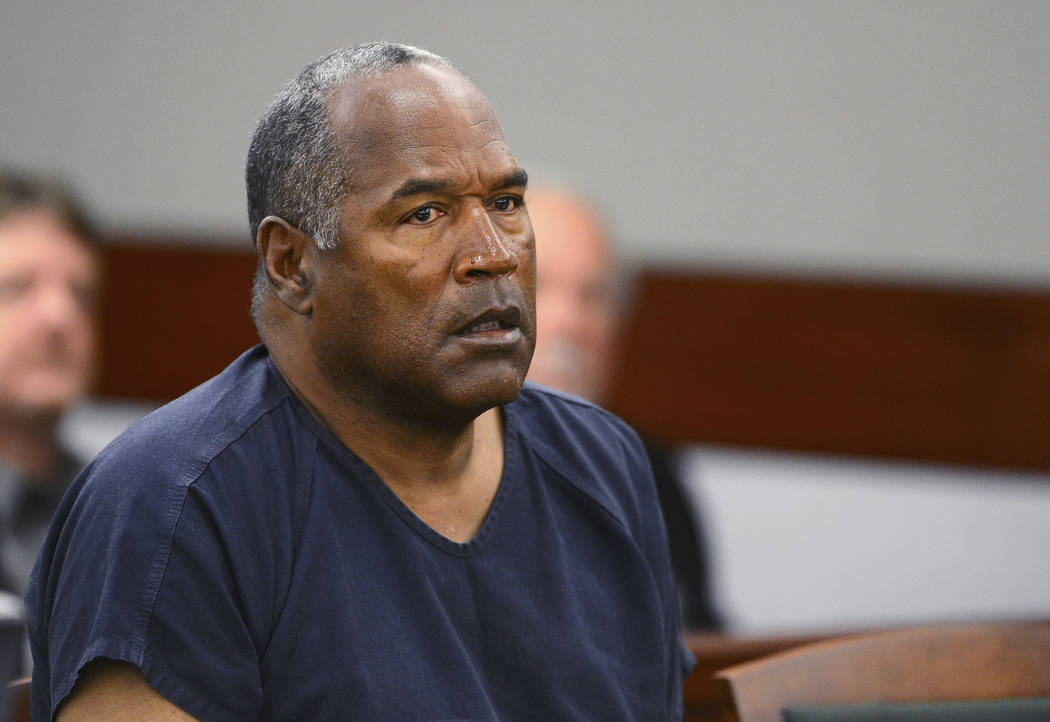 FILE - In this May 14, 2013, file photo, O.J. Simpson appears at an evidentiary hearing in Clark County District Court in Las Vegas. A Nevada prison official said early Sunday, Oct. 1, 2017, O.J.  ...