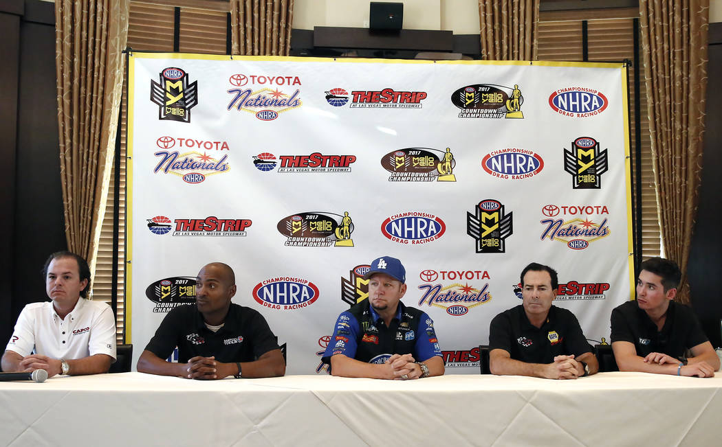 Steve Torrence, left, driver of the Capco Contractors / Torrence Racing dragster, Antron Brown, of the Match Tools / U.S. Army dragster, Robert Hight, center, of the Auto Club of Souther Californi ...