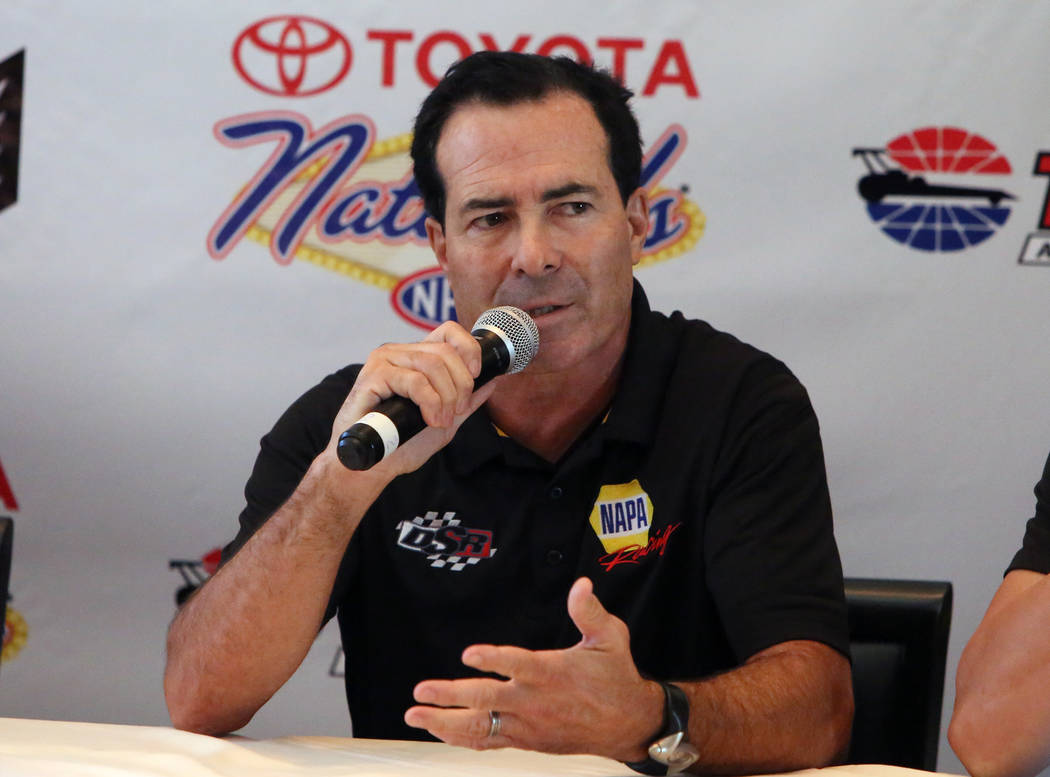 Ron Capps, driver of the NAPA Auto Parts Dodge Charger R/T Funny car, look on during the NHRA Mellow Yellow Drag Racing Series official event press conference Thursday, Oct. 26, 2017, in Las Vegas ...