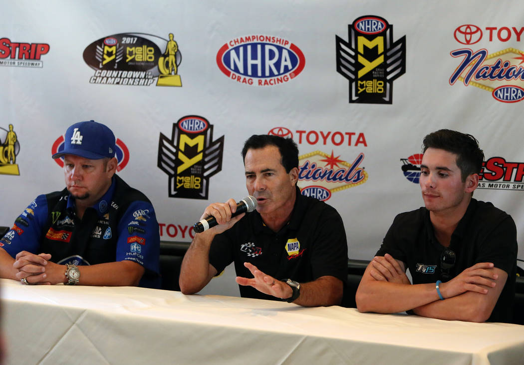 Ron Capps, driver of the NAPA Auto Parts Dodge Charger R/T Funny car, center, speaks as Robert Hight, left, of the Auto Club of Souther California Chevy Camaro Funny Car, and Tanner Gray of the Gr ...