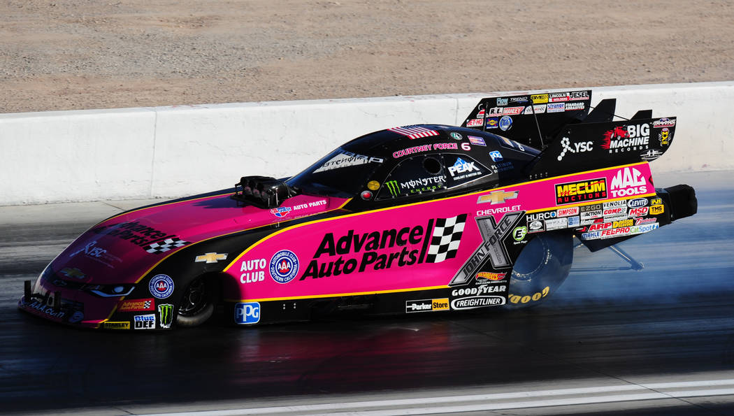 NHRA Funny Car driver Courtney Force spins the tires during the first round of qualifying for the Mello Yello NHRA Toyota Nationals at The Strip at Las Vegas Motor Speedway Friday October 27, 2017 ...