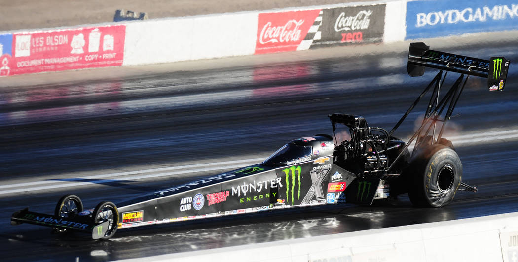 NHRA Top Fuel dragster driver Brittany Force makes a pass during the first round of qualifying for the Mello Yello NHRA Toyota Nationals at The Strip at Las Vegas Motor Speedway Friday October 27, ...