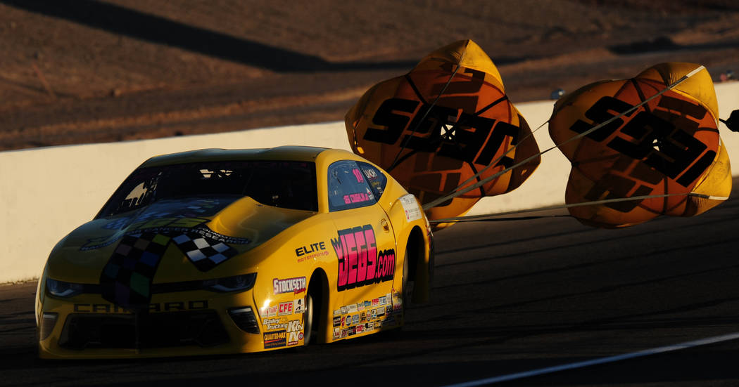 NHRA Pro Stock driver Jeg Coughlin deploys his parachutes after making a pass during the second round of qualifying for the Mello Yello NHRA Toyota Nationals at The Strip at Las Vegas Motor Speedw ...