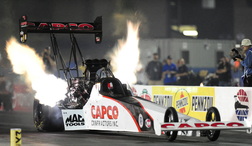 NHRA Top Fuel dragster driver Steve Torrence makes a pass of 3.694 seconds elapsed time at 330.15 MPH  during the second round of qualifying for the Mello Yello NHRA Toyota Nationals at The Strip  ...