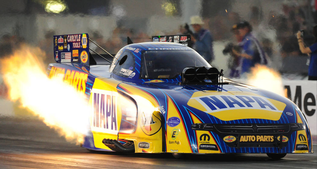 NHRA Funny Car driver Ron Capps makes a pass of 3.916 seconds elapsed time at 325.06 MPH during the second round of qualifying for the Mello Yello NHRA Toyota Nationals at The Strip at Las Vegas M ...
