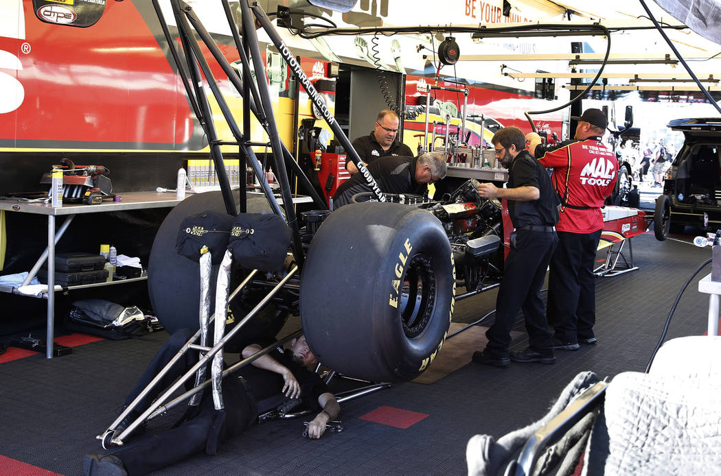 Funny Car racer Shawn Langston's car is worked on during the second round of qualifying for the Mello Yello NHRA Toyota Nationals event at Las Vegas Motor Speedway on Saturday, Oct. 28, 2017. Bizu ...