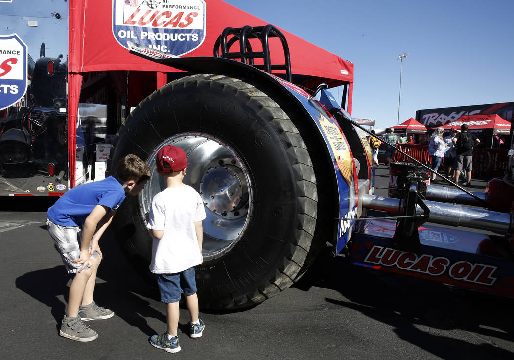 Owen Martin, 7, left, and his brother Connor, 5, both from Boulder City, check out giant tractor tire at the Mello Yello NHRA Toyota Nationals event at Las Vegas Motor Speedway on Saturday, Oct. 2 ...