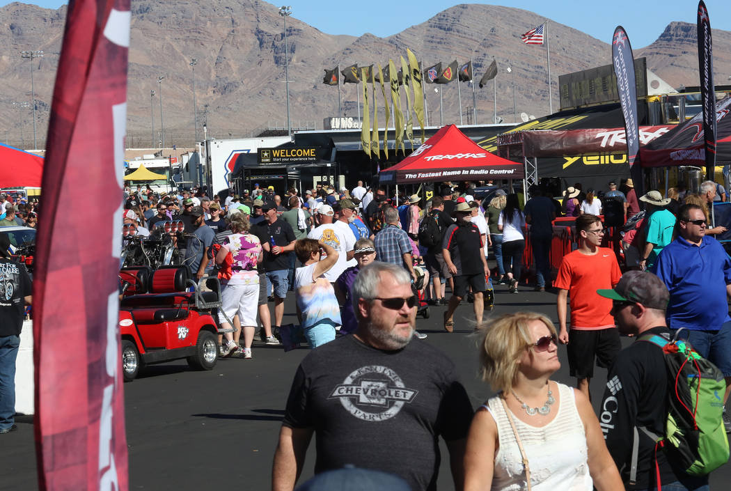 Fans walk the pit during the Mello Yello NHRA Toyota Nationals event at Las Vegas Motor Speedway on Saturday, Oct. 28, 2017. Bizuayehu Tesfaye/Las Vegas Review-Journal @bizutesfaye