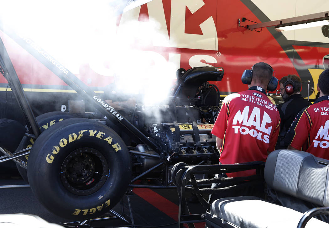 Funny Car racer Doug Kalitta's car is worked on during the second round of qualifying for the Mello Yello NHRA Toyota Nationals event at Las Vegas Motor Speedway on Saturday, Oct. 28, 2017. Bizuay ...