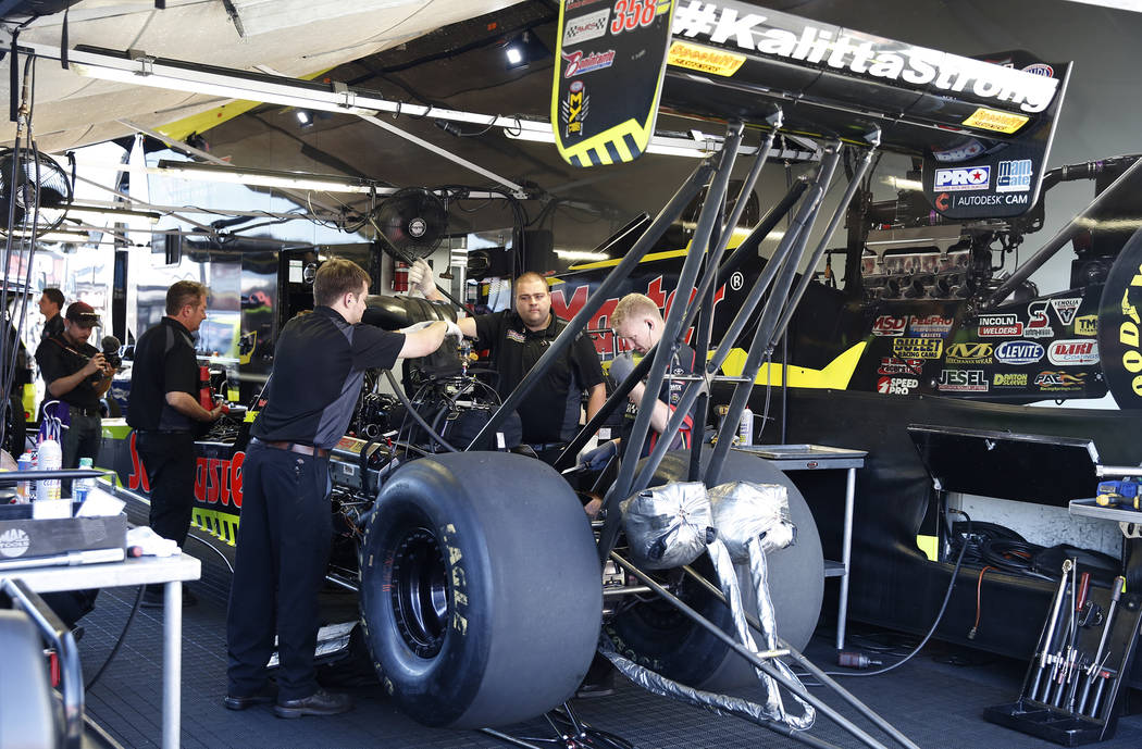 Funny Car racer Richie Crampton's car is worked on during the second round of qualifying for the Mello Yello NHRA Toyota Nationals event at Las Vegas Motor Speedway on Saturday, Oct. 28, 2017. Biz ...